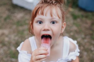 young girl with red tongue - Yummy! Magical Childhood Taste